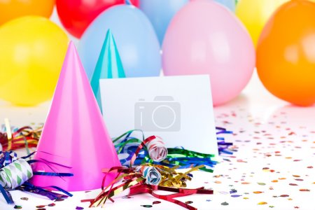 Photo for Birthday party decorations with a blank envelope - Royalty Free Image