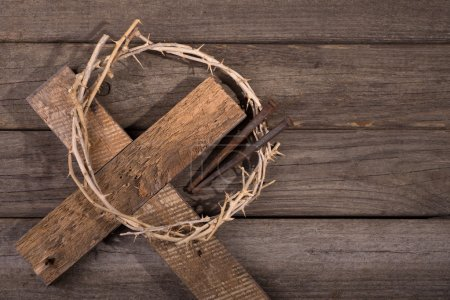 Photo for Crown of thorns with a cross and nails on a rustic wood surface - Royalty Free Image