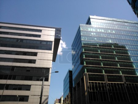 Office centers, sun glare on the glass walls of business center, White square in Moscow, Russia. Modern buildings.