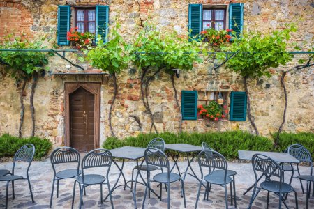 outside a quaint stone building in Tuscany, Italy