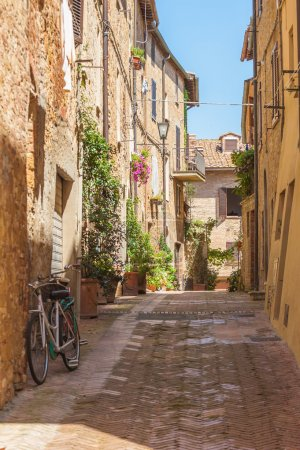 Sunny streets of Italian city Pienza in Tuscany