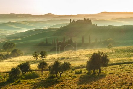 Tuscan landscape at sunrise in silence and colors of peace