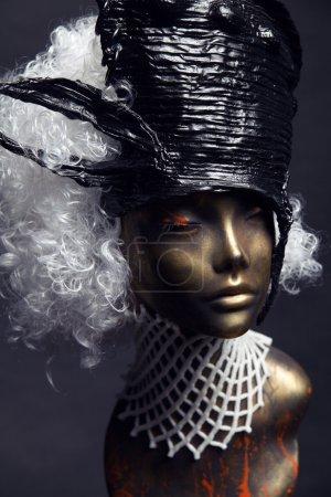 Mannequin in black head-wear