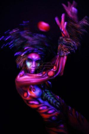 Woman with ultraviolet body art
