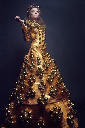 Woman in long golden dress