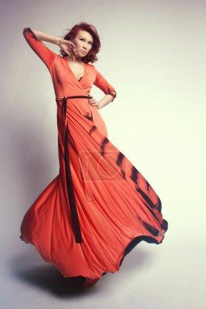 redhead woman in long dress