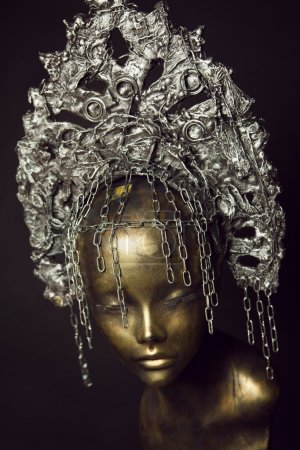 Mannequin in steel head wear with chains