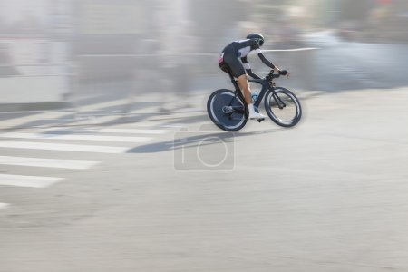 Individual Time Trial Cyclist on the Street
