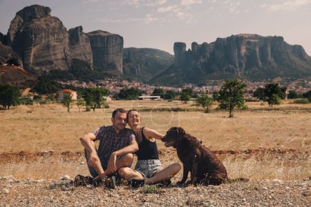 Beautiful couple of tourists in Greece with the Meteora Monaster