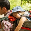 Active family hiking with 1,5 years child in carri...