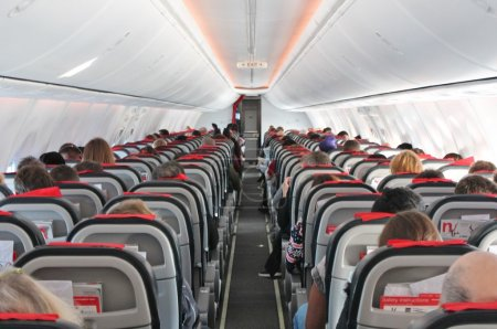 Airplane aircraft cabin seats flight aisle