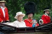QUEEN ELIZABETH, LONDON - JUNE 13: Queen Elizabeth II and Prince Philip seat on the Royal Coach at Queen's Birthday Parade, also known as Trooping the Colour, on June 13, 2015 in London, England.