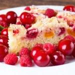 Постер, плакат: Detail view on slice of fruit pie with berries around