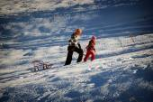 Young people traveling in Russia. Girl and woman trekkers on snow trail in forest.
