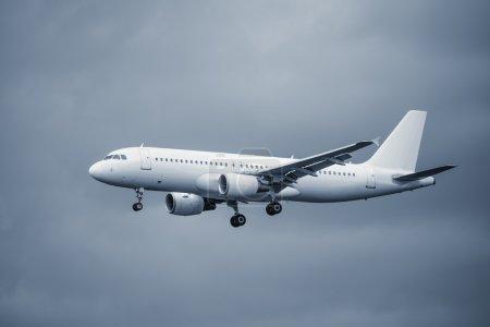 Landing passenger plane.