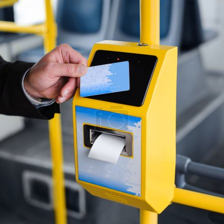 Photo for Human hand holding plastic cards. Passenger pays for the fare in public transport. Payment terminal, credit card reader, sales concept. - Royalty Free Image