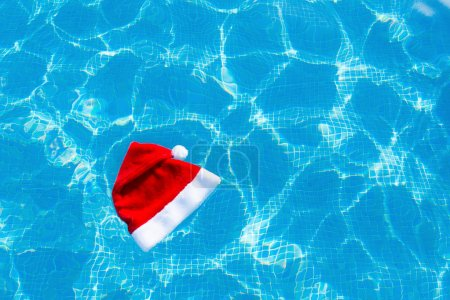 Christmas hat floating on the water of a swimmingpool