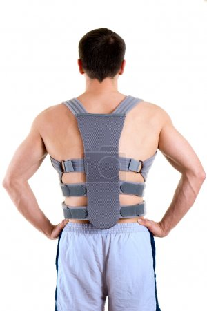 Athletic Man Wearing Supportive Back Brace