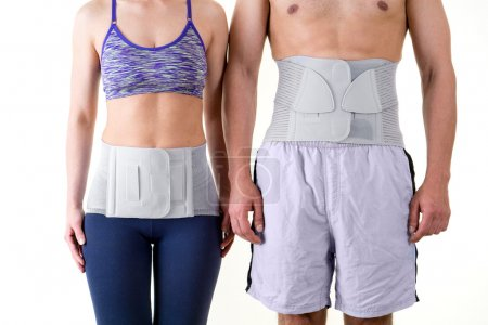 Man and Woman Wearing Back Support Braces