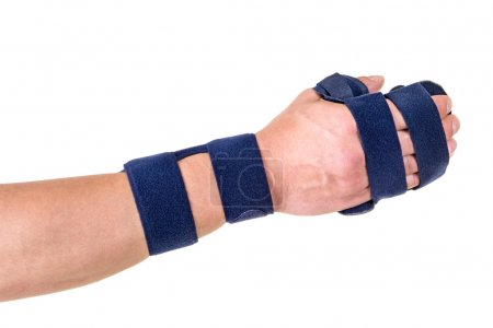 Photo for Close Up of Person with Velcro Straps Securing Supportive Hand and Wrist Brace in Studio with White Background. - Royalty Free Image