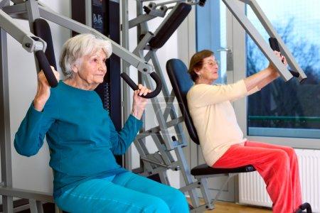 Serious senior women in gym