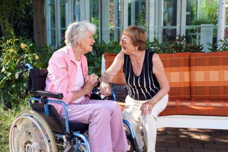 Elderly friends chatting