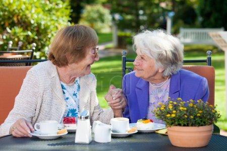 Senior Women Relaxing at Garden Table