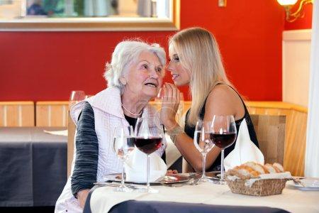 Women Talking at Restaurant