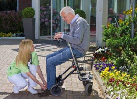 Nurse Helping Senior Man