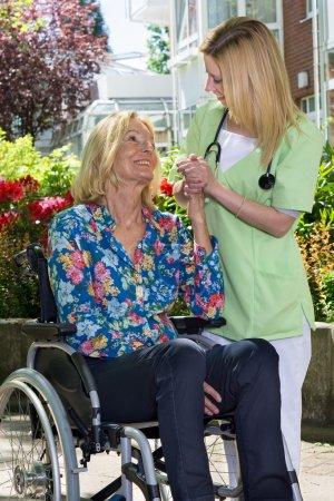 Nurse Standing Beside Senior Woman