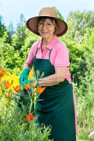 Senior Woman watering flowers