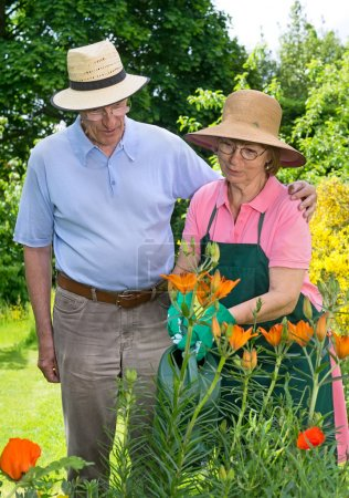 man and woman Watering  Flowers