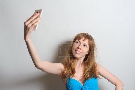 Pretty girl taking selfie
