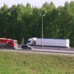 Постер, плакат: Trucks move on road
