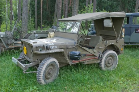 "Retro car Willys MB in the forest at the 3rd international meeting of "" Motors of war"" near the town of Chernogolovka, Moscow region"