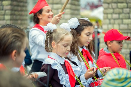 Moscow, Russia - September 11, 2016: Moscow City Day. Moscow residents and guests celebrate the 869 anniversary of the city. Performance on Tverskaya Street. Public-event. Pioneer drummer children.