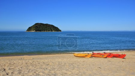 Kayaks at the beach and small island