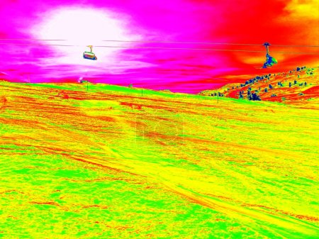 The cab lift above slope in Alps ski region. Sunny winter day, huge of snow. Infrared photo in magic thermography colors.