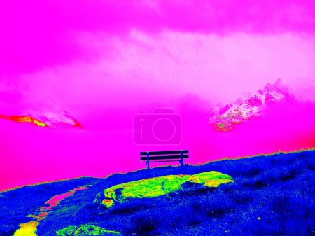 Wooden bench in mountains, infrared photo. Amazing thermography. Hilly landscape in background.