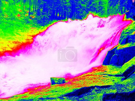Foamy water level of waterfall, curves between boulders of rapids. Water of mountain river in infrared photo. Amazing thermography.