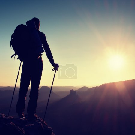 Photo for Tall male hiker in the mountain landscape at sunset. Beautiful colorful mountain panorama in the evening in the mountains. - Royalty Free Image