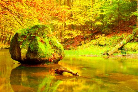 Watercolor paint. Paint effect.Autumn mountain river with blurred waves,, fresh green mossy stones and boulders on river bank covered with colorful leaves