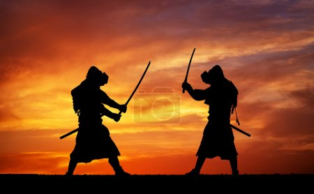 Silhouette of two samurais in duel. Picture with two samurais