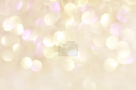 Gold and purple abstract bokeh lights, defocused background