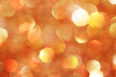 Gold, silver, red, white, orange abstract bokeh lights, defocused background Christmas background