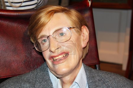 Photo pour London, - United Kingdom, 08, July 2014. Madame Tussauds in London.  Waxwork statue of Stephen Hawking.  Created by Madam Tussauds in 1884, Madam Tussauds is a waxwork museum and tourist attraction - image libre de droit