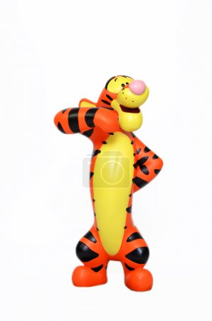 Photo for Monchique, Faro - Portugal, June 27, 2013. Studio image of Tigger with a white isolated background. Disney's Tigger is striking one of his famous poses.  Tigger was created by A.A.Milne. - Royalty Free Image