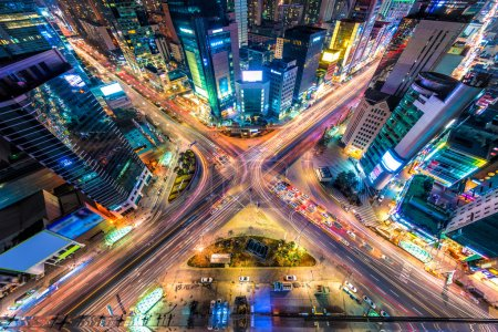 Photo for Looking down on a major interstection at night in Seoul, South Korea. - Royalty Free Image