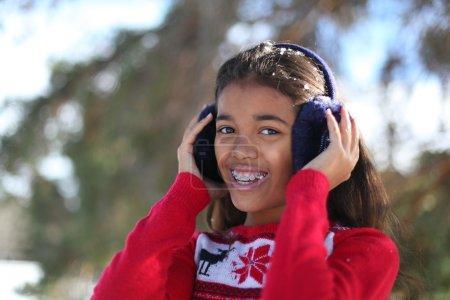 Beautiful tween girl in a winter park