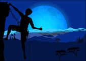 Silhouette of climber showing thumb up against the night mountain landscape